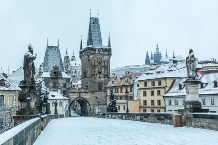 prague: Snow Covered Charles Bridge in Prague Stock Photo
