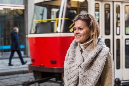 czech republic: Young Woman at Tram Stop