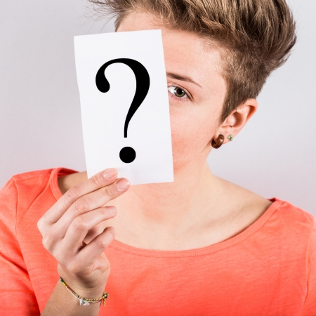 Young Woman Holding Question Mark photo