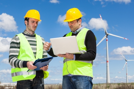 Two Engineers in a Wind Turbine Power Station photo