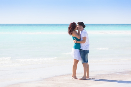 Young Couple Embraced in a Caribbean Beach photo
