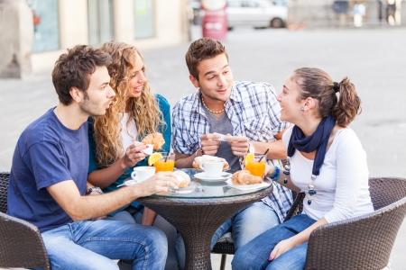 juice bar: Group of Friends Having a Traditional Italian Breakfast Stock Photo