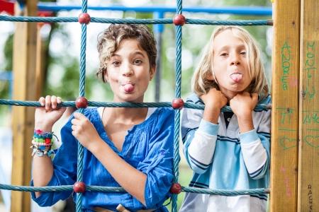 Happy Children Playing at Playground photo
