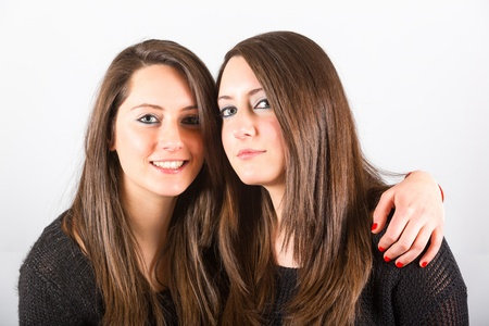 embraced: Two Beautiful Twin Sisters Embraced