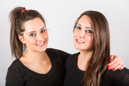 Two Beautiful Twin Sisters Embraced photo
