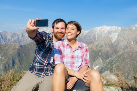 telephone together: Couple Taking Self Portrait at Top of Mountain