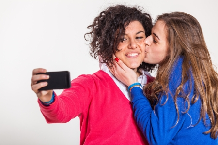 black lesbian: Two Beautiful Women Taking Self Portrait with Mobile Phone