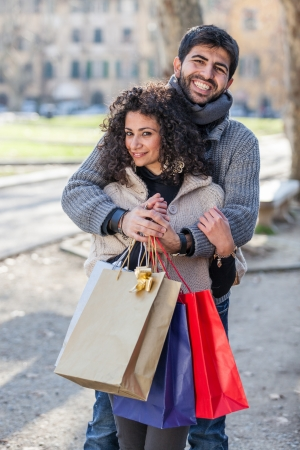 Happy Young Couple with Shopping Bags photo
