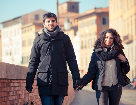 Young Couple Walking in the City with Shopping Bags photo