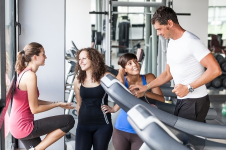 gym girl: Attractive Man at Gym with Three Women Stock Photo
