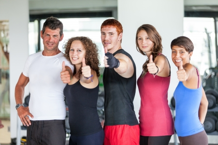 thumbs up group: Group of People at Gym with Thumbs Up