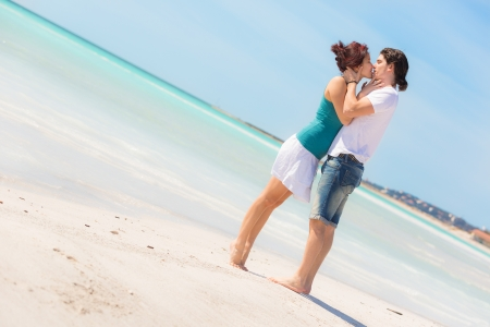 young lovers: Young Couple Embraced in a Caribbean Beach