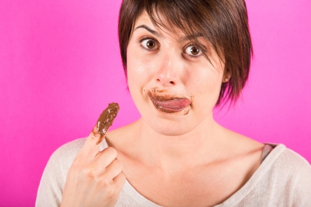 finger licking: Young Woman with Chocolate Cream