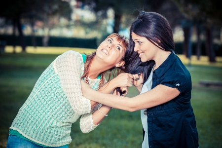 Two Young Women Fighting photo