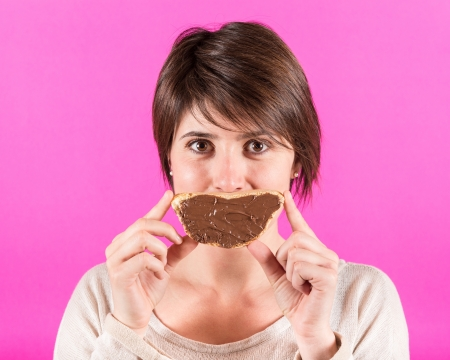 Young Woman with Chocolate Cream photo