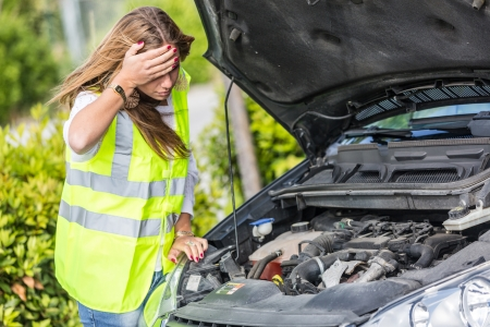 car trouble: Young Woman with Damaged Car