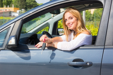 Happy Young Woman Showing Car Key photo