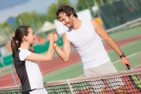 Tennis Players Giving Handshake photo