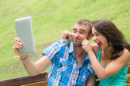 joking: Happy Young Couple Taking Self Portrait