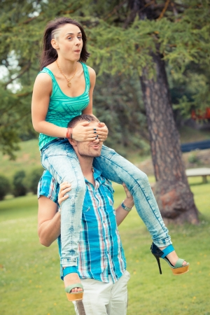 Young Couple having Piggyback Ride photo