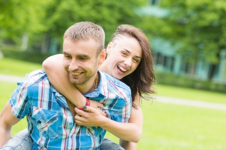 europe eastern: Young Couple having Piggyback Ride Stock Photo