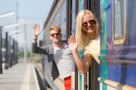 hand rails: Couple Leaving for Vacation with Train