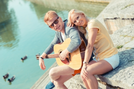 russian man: Young Couple with Guitar at Park