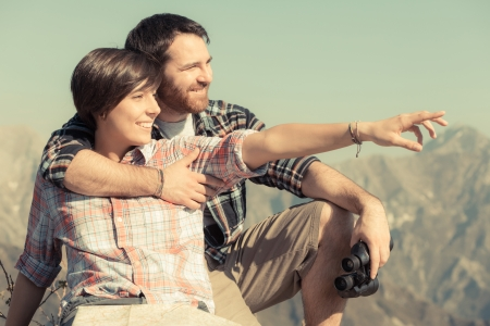 Young Couple at Top of Mountain photo