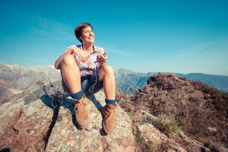 Young Woman at Top of Mountain photo