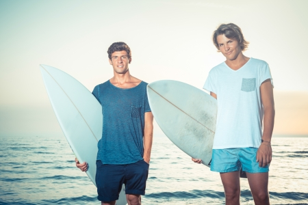 Two Boys with Surf Boards at Sunset photo