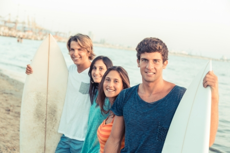 Group of Friends with Surf Boards photo