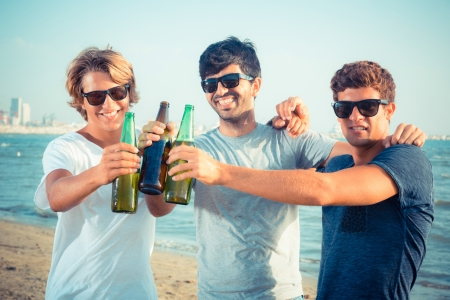 friends party: Group of Boys Cheering at Beach