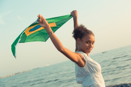 brazil country: Brazilian Girl with National Flag at Beach Stock Photo