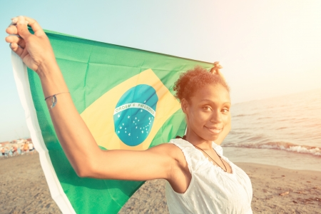 Brazilian Girl with National Flag at Beach photo
