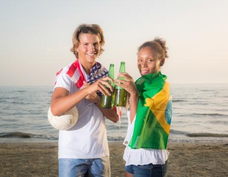 American Boy with Brazilian Girl at Beach Stock Photo - 21701650