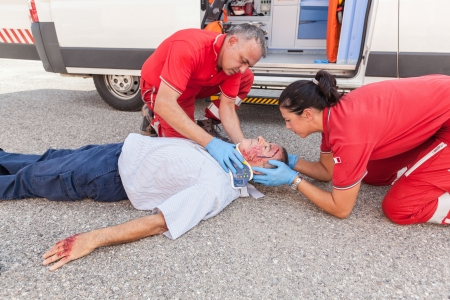 first help: Rescue Team Providing First Aid