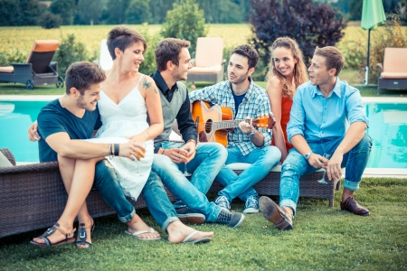 person outside: Group of Friend Singing Together next to Swimming Pool