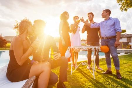 パーティーで乾杯お友達のグループ 写真素材