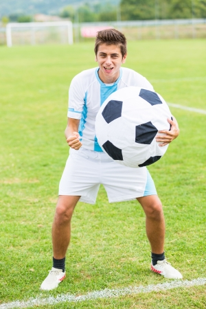 Soccer Player with Funny Big Ball photo