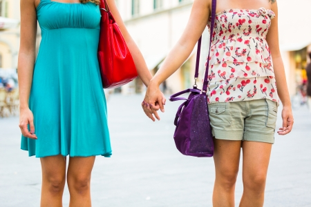 lesbian couple: Two Women Holding Hands in the City Stock Photo