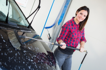 Young Woman Washing Car photo