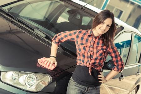Young Woman Washing Car photo