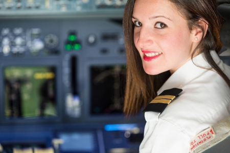 airline pilot: Female Pilot in the Airplane Cockpit Stock Photo