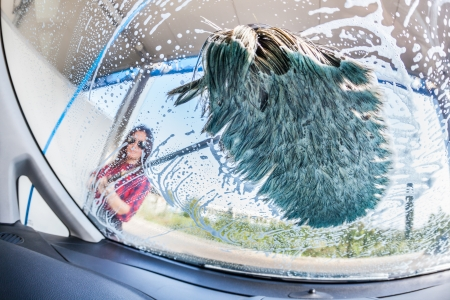 Young Woman Washing Car, interior view photo