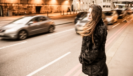 Young Woman Along London City Street photo