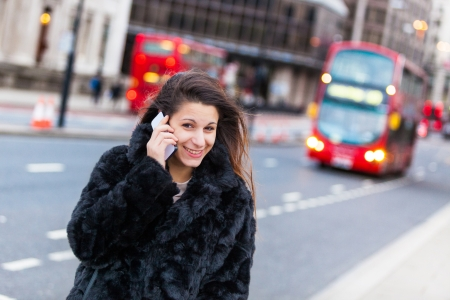 Young Woman on the Phone in London City photo