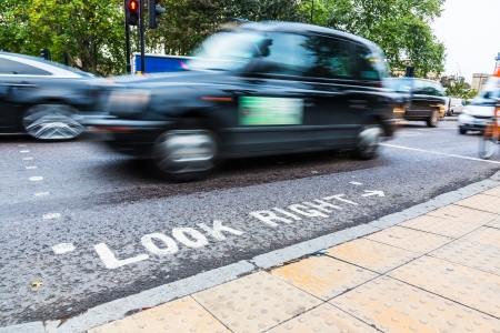look at right: Look Right Sign and Blurred Traffic in London Stock Photo