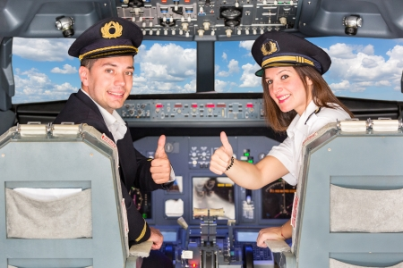 Happy Pilots in the Cockpit with Thumbs Up photo