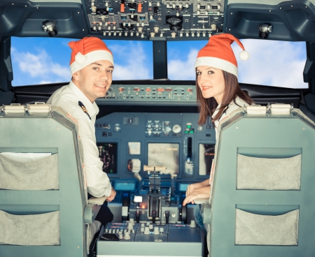 Pilots in the Cockpit with Santa Hat photo