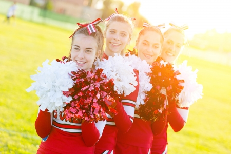 adult cheerleader: Group of Cheerleaders in the Field Editorial
